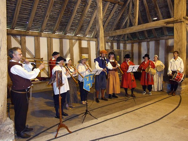 Massed performance by tutors and workshop participants at Cressingham Temple Barns